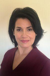 Idania, the patient coordinator and insurance guru for Douglas A. Deam, DMD, PA